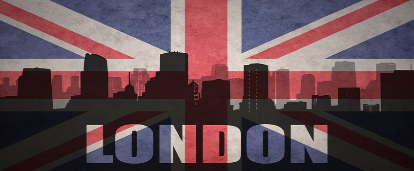 abstract silhouette of the city with text London at the vintage british flag background