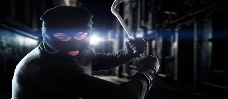 Thief holding a crowbar