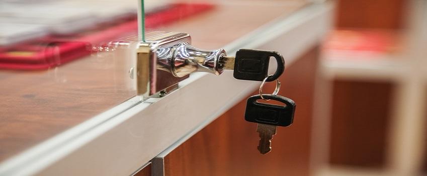 Key in showcase lock in the shop, close-up shot